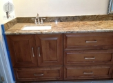 <p>Stained Maple; Drawer below Sink</p>